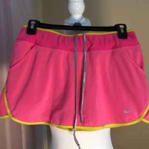 Nike pink and yellow running skirt. Size small